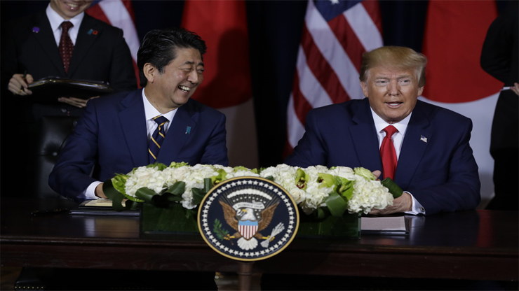 trump and abe - US, Japan sign limited trade deal, leaving autos for future talks