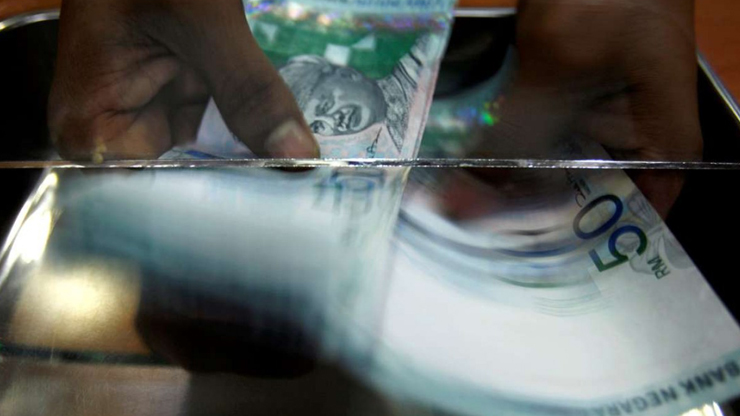 Ringgit opens marginally lower against US dollar - Ringgit opens marginally lower against US dollar